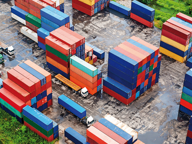17080969 – stack of freight containers at the docks with truck