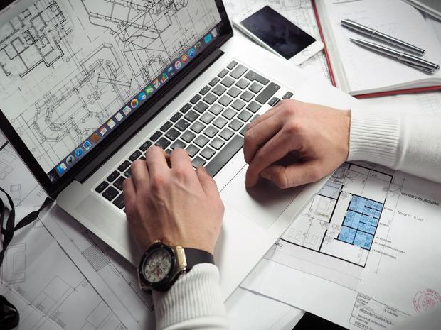 3150518_blueprints-entrepreneur-hands-110469