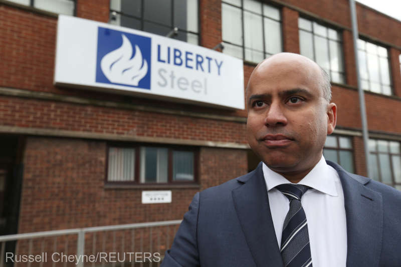 FILE PHOTO: Liberty Steel boss Sanjeev Gupta stands outside steel pressing mill in Dalzell, Scotland
