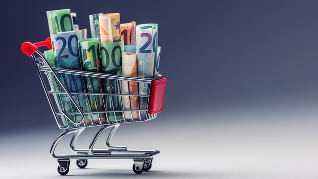 Shopping trolley full of euro money – banknotes – currency. Symbolic example of spending money in shops, or advantageous purchase in the shopping center