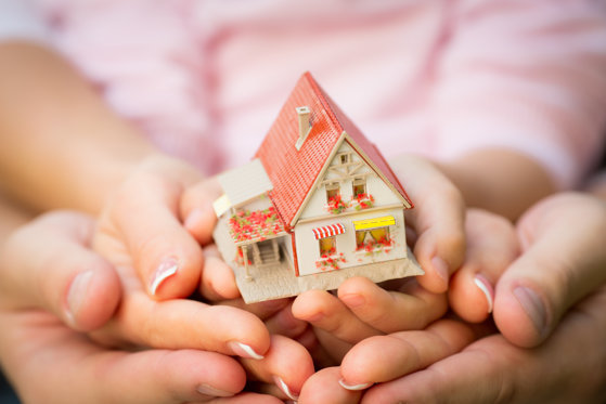 Family holding house