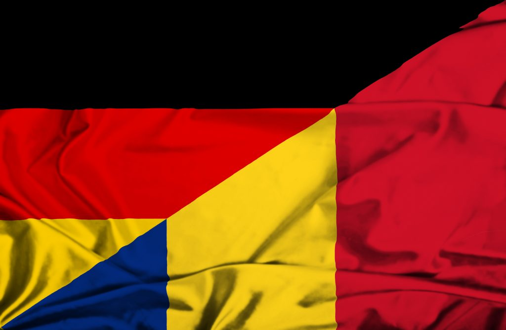 Waving flag of Romania and Germany